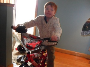 a boy a bike and a spanking brand new sweater
