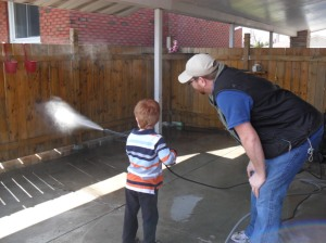 Daddy teaching our future patio cleaner